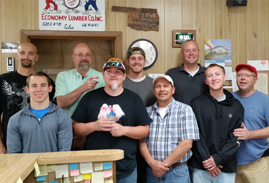 Group picture of Economy Lumber Company staff members
